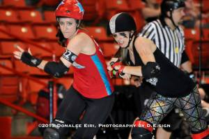 Dani Get Your Guns in action. In red.